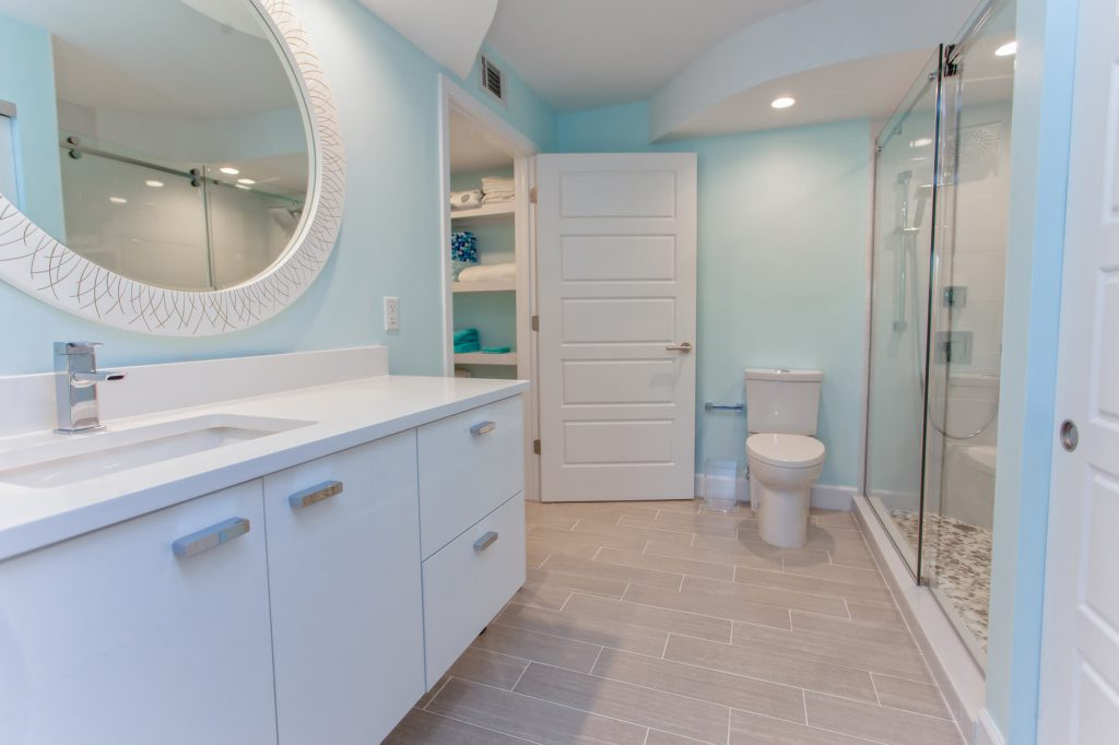 Floating Gloss Vanity in Bathroom Renovation in Lee & Collier County