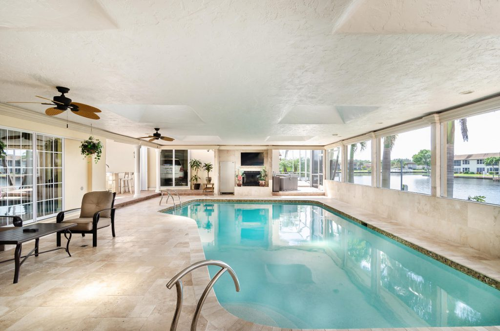 Sunroom Remodel with Indoor Pool in Cape Coral, FL Home