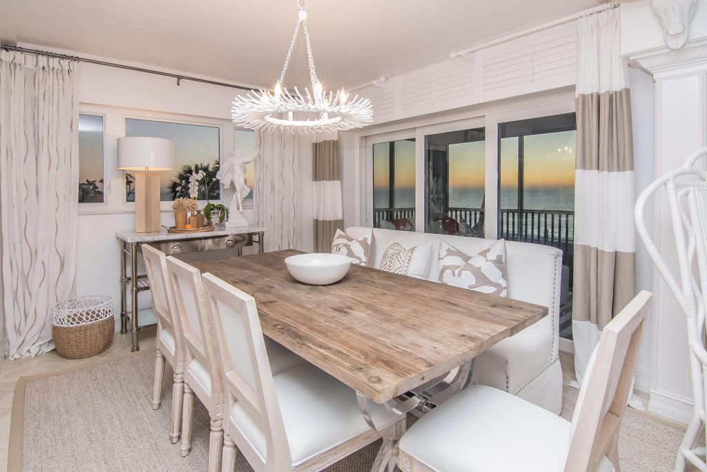 Luxury Dining Room Renovation in Lion's Gate Tribout FL with Beach Style