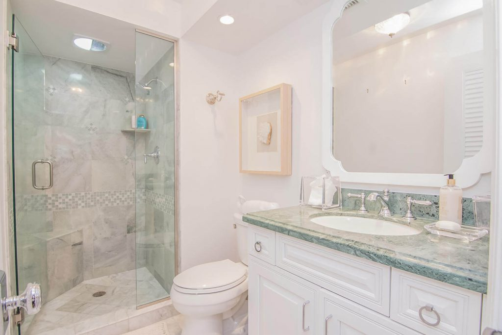 White and Green Bathroom Remodel with Stone Tile in Lion's Gate Tribout FL