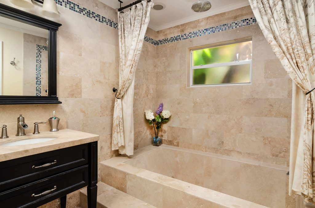 Custom Travertine Tub and Tile Bathroom Remodel in Cape Coral, FL