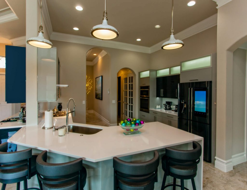 Bonita Lakes, FL Kitchen Remodel with Bar stools and White Countertop