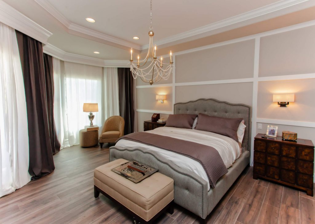 Master Bedroom with Luxury Style and Chandelier in Bonita Lakes, FL Home